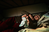 "SERBIA, Belgrade, Jan. 18, 2007..Julka Jaunkovic (73) refugee from Kosovo, Pec, laying in her room in a refugee camp ""Krnjaca"" near Belgrade..© Djordje Jovanovic /EST&OST"