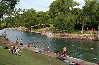 Diving board is a favorite year round for swimmers at Barton Springs Swimming Pool in Austin, Texas, USA