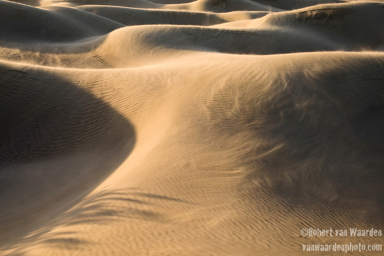 Wind devils rip across the Mesquite Sand Dunes - Death Valley National Park, California.