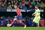 Club Atletico de Madrid's Lucas Hernandez and Futbol Club Barcelona's Leo Messi (R)  during La Liga match. November 24,2018. (ALTERPHOTOS/Alconada)