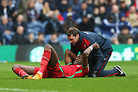 Tammy Abraham of Swansea City receives treatment after being crushed by Ben Foster of West Bromwich Albion during the Premier League match between Swansea City and West Bromwich Albion at the Hawthorns Stadium, Birmingham, England, UK. Saturday 07 April 2018