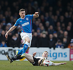 Fraser Aird rides the tackle of Ayr's Craig Malcolm