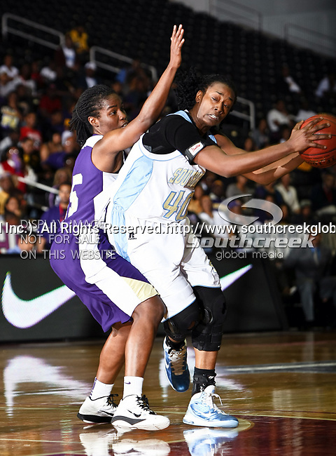 Prairie View A&M Lady Panthers guard Trinity Robinson (15) and Southern University Jaguars forward Freda Allen (40) in action during the SWAC Tournament Championship game between the Prairie View A&M Lady Panthers and the Southern University Jaguars at the Special Events Center in Garland, Texas. Prairie View defeats  Southern 48 to 44
