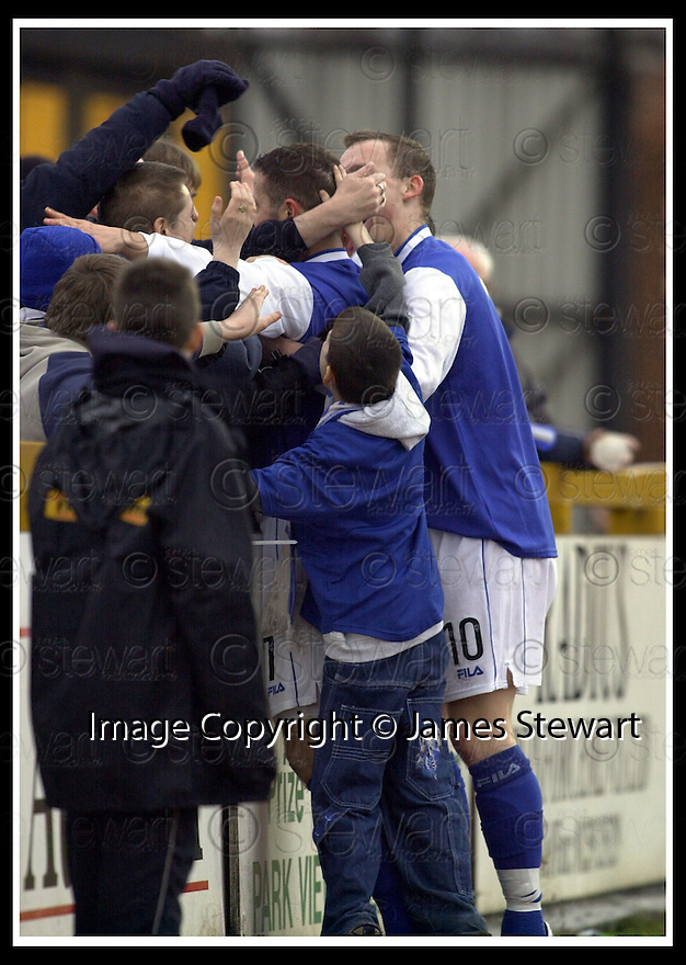 18/01/2003                   Copyright Pic : James Stewart.File Name : stewart-alloa v qots08.JOHN O'NEIL CELEBRATES WITH THE FANS AND TEAM MATE PETER WEATHERSON (10) AFTER HE SCORED THE FIRST GOAL.....James Stewart Photo Agency, 19 Carronlea Drive, Falkirk. FK2 8DN      Vat Reg No. 607 6932 25.Office     : +44 (0)1324 570906     .Mobile  : +44 (0)7721 416997.Fax         :  +44 (0)1324 570906.E-mail  :  jim@jspa.co.uk.If you require further information then contact Jim Stewart on any of the numbers above.........