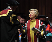 Pictured: Hillary Clinton on stage is being handed a commemorative book of her family tree at Swansea University Bay Campus. Saturday 14 October 2017<br /> Re: Hillary Clinton, the former US secretary of state and 2016 American presidential candidate will be presented with an honorary doctorate during a ceremony at Swansea University's Bay Campus in Wales, UK, to recognise her commitment to promoting the rights of families and children around the world.<br /> Mrs Clinton's great grandparents were from south Wales.