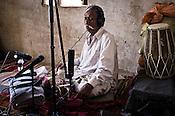 66-year-old Manganiyar artist, Lakha Khan listens to the field recording of his Sarangi in his house in Raneri village of Jodhpur district in Rajasthan, India. Photo: Sanjit Das/Panos