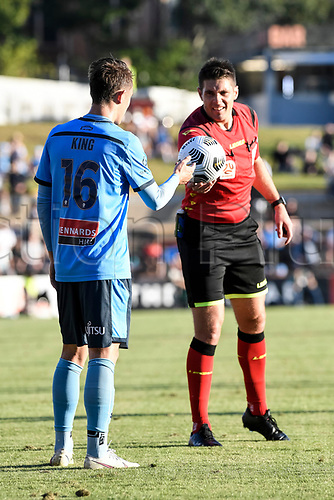 18th April 2021; Leichardt Oval, Sydney, New South Wales, Australia; A League Football, Sydney Football Club versus Adelaide United; referee Shaun Evans restarts the game by handing the ball to Joel King of Sydney