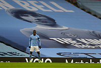 10th January 2021; Etihad Stadium, Manchester, Lancashire, England; English FA Cup Football, Manchester City versus Birmingham City; Benjamin Mendy of Manchester City in front of a banner of the late Colin Bell