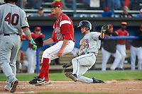 Mahoning Valley Scrappers outfielder Nathan Lukes (39) slides into home as pitcher Jeffrey Kinley (30) waits for a throw while covering during a game against the Batavia Muckdogs on June 23, 2015 at Dwyer Stadium in Batavia, New York.  Mahoning Valley defeated Batavia 11-2.  (Mike Janes/Four Seam Images)