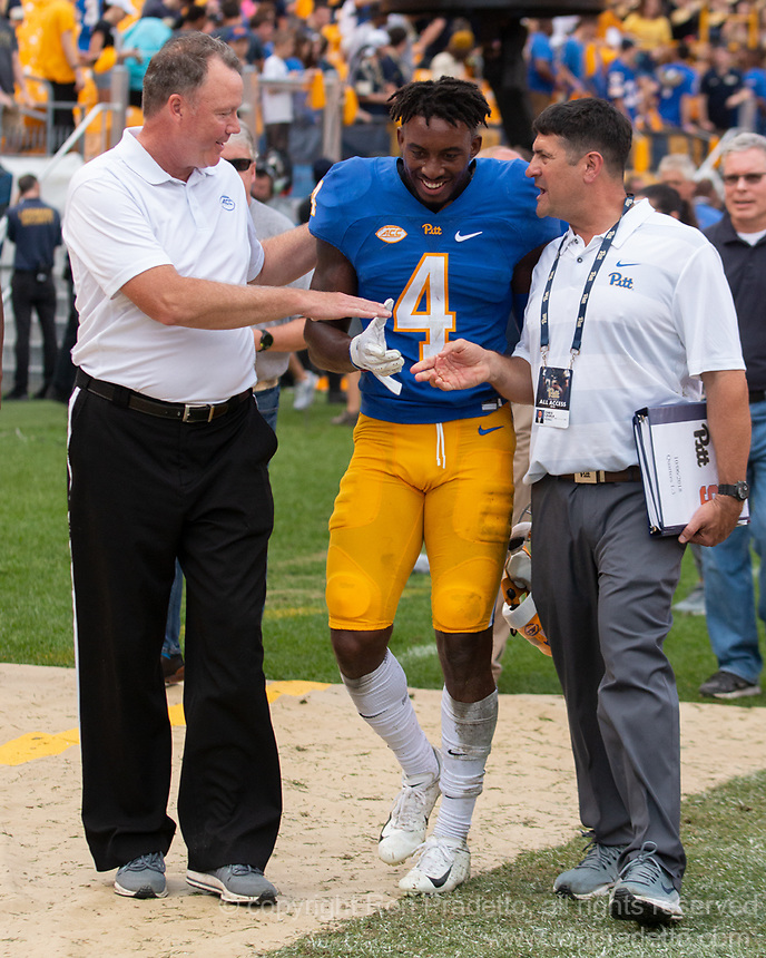 Pitt defensive back Therran Coleman (4) gets congratulations from staff for his interception to win the game. The Pitt Panthers defeated the Syracuse Orange 44-37 in overtime at Heinz Field in Pittsburgh, Pennsylvania on October 6, 2018.