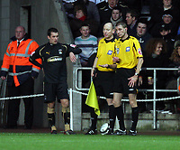 Pictured: One of the linesmen (C) passes on small items to match referee Steve Tanner (R) that were thrown to a Coventry City player (L) who was about to take a corner kick.<br /> Re: Coca Cola Championship, Swansea City FC v Coventry City at the Liberty Stadium. Swansea, south Wales, Friday 26 December 2008.<br /> Picture by D Legakis Photography / Athena Picture Agency, Swansea 07815441513