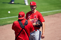St. Louis Cardinals pitcher Matthew Liberatore (52) talks with team photographer Billy Hurst before a Major League Spring Training game against the New York Mets on March 19, 2021 at Clover Park in St. Lucie, Florida.  (Mike Janes/Four Seam Images)
