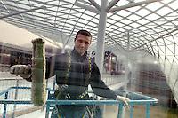 - the new Milan fair at Rho-Pero, Rumanian clean glasses worker....- la nuova fiera di Milano a Rho-Pero, operaio romeno lavavetri