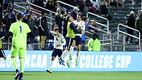 CARY, NC - DECEMBER 15: Joe Bell #8 of University of Virginia celebrates his goal with teammates during a game between Georgetown and Virginia at Sahlen's Stadium at WakeMed Soccer Park on December 15, 2019 in Cary, North Carolina.