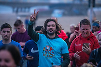 BNPS.co.uk (01202 558833)<br /> Pic: MaxWillcock/BNPS<br /> <br /> Pictured: Joe Wicks during the run.<br /> <br /> Hundreds of runners responded to an Instagram invitation to join the nation's favourite PE teacher Joe Wicks on an early morning 5km run from Bournemouth Pier to Boscombe Pier and back.<br /> <br /> Avid fans of The Body Coach had to wake up at the crack of dawn to meet Joe Wicks at 7am for the run down the promenade.