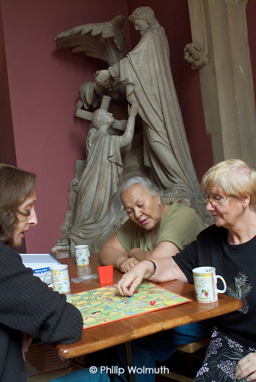 A games afternoon at a drop in session run by Open Age, a community organisation providing services for the over-50s, at St.Stephen's Church, Bayswater, London.