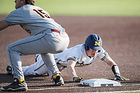 Michigan Wolverines third baseman Jimmy Kerr (15) dives back to first base against the Central Michigan Chippewas on May 9, 2017 at Ray Fisher Stadium in Ann Arbor, Michigan. Michigan defeated Central Michigan 4-2. (Andrew Woolley/Four Seam Images)