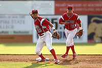 Batavia Muckdogs shortstop Anthony Melchionda #16 turns a double play as Jacob Wilson #32 looks on during an exhibition game against the Newark Pilots of the Perfect Game Collegiate Baseball Lague at Dwyer Stadium on June 15, 2012 in Batavia, New York.  Batavia defeated Newark 8-0.  (Mike Janes/Four Seam Images)