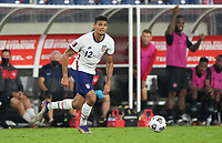 NASHVILLE, TN - SEPTEMBER 5: Miles Robinson #12 of the United States looking for an open man during a game between Canada and USMNT at Nissan Stadium on September 5, 2021 in Nashville, Tennessee.