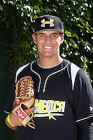 Pitcher Brady Aiken of Cathedral Catholic High School in Jamul, California poses for a photo before participating in the Under Armour All-American Game powered by Baseball Factory at Wrigley Field on August 17, 2012 in Chicago, Illinois.  (Mike Janes/Four Seam Images)