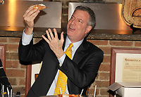STATEN ISLAND, NY - JANUARY 10: As a pizza was placed in front of the new mayor, he made a fateful move: He picked up a fork and knife. The mayor of New York City eats his pizza like a tourist. Mayor Bill de Blasio on Friday traveled to Staten Island for a lunch meeting at a famous pizza joint — and raised eyebrows by eating his slice with a knife and a fork. De Blasio's use of cutlery, rather than New York's tried-and-true folding method, put him in the minority at a table of ten small business owners and locals on January 10, 2014 in New York City.<br /> <br /> People:  Mayor Bill de Blasio