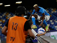 26th September 2021; Maradona Stadium, Naples, Italy; Serie A football, Napoli versus Cagliari :  Victor Osimhen of Napoli leaps the advertisiing boards and celebrates after scoring his goal for 1 -0 - in 11th minute