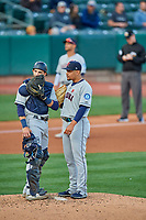 Tacoma Rainiers starting pitcher Justus Sheffield (10) and Austin Nola (14) meet at the mound during the game against the Salt Lake Bees at Smith's Ballpark on May 27, 2019 in Salt Lake City, Utah. The Bees defeated the Rainiers 5-0. (Stephen Smith/Four Seam Images)