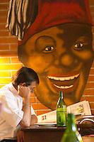 man reading paper restaurant le bistrot crozes hermitage rhone france