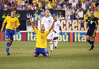 Michael Bradley #4 of the USA watches as Neymar #11 of Brazil celebrates after scoring the first goal during an international friendly matchl in Giants Stadium, on August 10 2010, in East Rutherford, New Jersey.Brazil won 2-0.