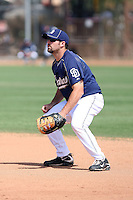 Cody Decker #13 of the San Diego Padres participates in spring training workouts at the Padres minor league complex on March 19, 2011  in Peoria, Arizona. .Photo by:  Bill Mitchell/Four Seam Images.