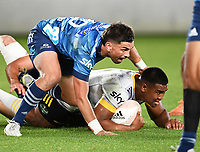 3rd April 2021; Eden Park, Auckland, New Zealand;  Hurricanes winger Julian Savea runs into Otere Black.<br /> Blues v Hurricanes Super Rugby Aotearoa. Eden Park, Auckland. New Zealand.