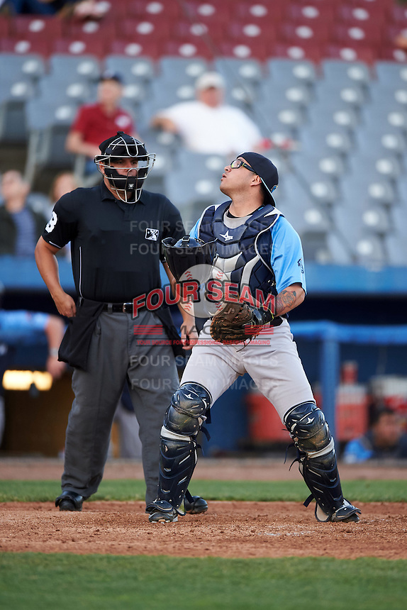 Trenton Thunder catcher Sebastian Valle (52) looks for a foul ball popup in front of umpire Jorge Teran during the second game of a doubleheader against the Hartford Yard Goats on June 1, 2016 at Sen. Thomas J. Dodd Memorial Stadium in Norwich, Connecticut.  Trenton defeated Hartford 2-1.  (Mike Janes/Four Seam Images)