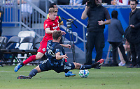 CARSON, CA - FEBRUARY 15: Nick DePuy #20 of the Los Angeles Galaxy attempts to slide tackle Jacob Shaffelburg #24 of Toronto FC during a game between Toronto FC and Los Angeles Galaxy at Dignity Health Sports Park on February 15, 2020 in Carson, California.
