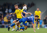 4th September 2021; Merton, London, England;  EFL Championship football, AFC Wimbledon versus Oxford City: Will Nightingale of AFC Wimbledon challenges Matty Taylor of Oxford United
