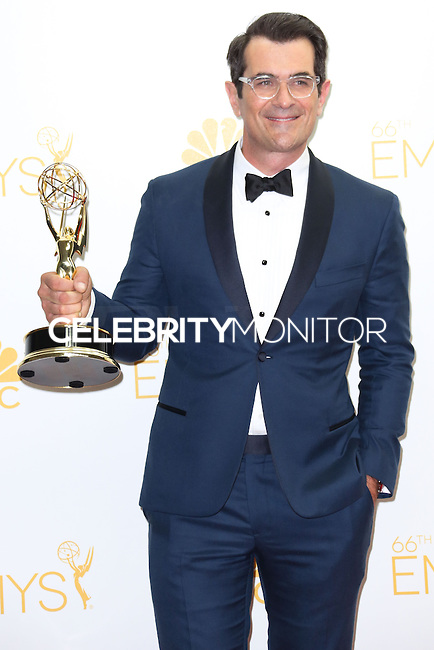 LOS ANGELES, CA, USA - AUGUST 25: Actor Ty Burrell, winner of the Outstanding Supporting Actor in a Comedy Series Award for 'Modern Family' poses in the press room at the 66th Annual Primetime Emmy Awards held at Nokia Theatre L.A. Live on August 25, 2014 in Los Angeles, California, United States. (Photo by Celebrity Monitor)