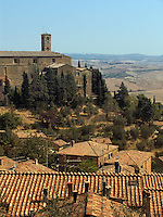 Tile roofed homes and monastery of Saint Agostino and church, Montalcino, Ital
