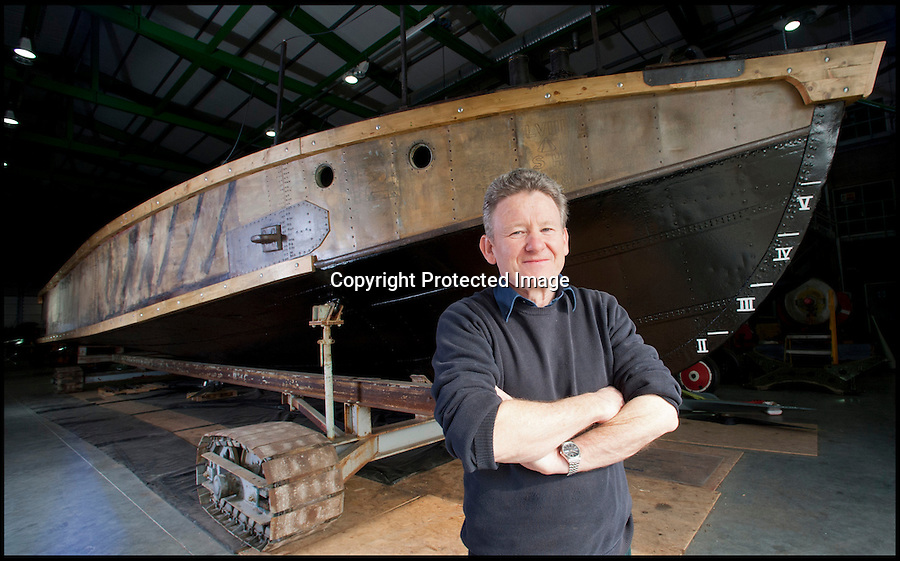 BNPS.co.uk (01202 558833)<br /> Pic: LauraJones/BNPS<br /> <br /> Curator of Aircraft Dave Morris.<br /> <br /> Worlds first Aircraft Carrier restored.<br /> <br /> An amazing tale of bravery and ingenuity from the First World War has been revealed as the worlds first aircraft carrier has been restored at the Fleet air arm museum in Somerset.<br /> <br /> Measuring just 58ft long, the precarious craft was invented to counter the threat of Zepplin raids over London and enabled a plucky pilot to launch his Sopwith Camel at the enemy from the North sea before the feared airships could reach Britain.<br /> <br /> The tiny carriers were towed out from port behind a battleship with the aircraft strapped to the top of a wooden ramp. The crew and pilot would have to endure the conditions before an enemy was spotted and the ship then towed them into wind as fast as they could.<br /> <br /> The pilot had just 58ft of 'runway' to get the plane airborne or it would plummet into the sea with disastrous consequences.<br /> <br /> A team of seamen had to hold the plane back while the pilot got the engine up to speed then release the chocks at the right moment.<br /> <br /> Incredibly even if the plane made it into the air, the only way the pilot could land again was by crashing into the sea in the hope of being rescued.