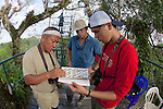 Jake, Pat & Meyer With Bird Identification Book On Canopy Tower, Tiputini