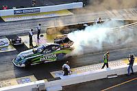 Oct. 14, 2011; Chandler, AZ, USA; NHRA funny car driver Alexis DeJoria during qualifying at the Arizona Nationals at Firebird International Raceway. Mandatory Credit: Mark J. Rebilas-