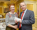 Clare Champion MD John Galvin presenting Michelle Timony of Forget Me Not with second prize at the announcement of the winners of the annual Clare Champion Christmas Shop Window Display competition in the Old Ground hotel, Ennis. Photograph by John Kelly.