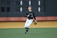 Wake Forest Demon Deacons left fielder Chris Lanzilli (24) tracks a fly ball during the game against the Illinois Fighting Illini at David F. Couch Ballpark on February 16, 2019 in  Winston-Salem, North Carolina.  The Fighting Illini defeated the Demon Deacons 5-2. (Brian Westerholt/Four Seam Images)