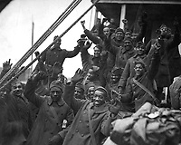 """The famous 369th arrive in N.Y. City.  Members of the 369th Colored Inf., formerly 15th N.Y. regulars.  """"Back to little old New York"""".  1919.  Paul Thompson. (War Dept.)<br /> Exact Date Shot Unknown<br /> NARA FILE #:  165-WW-127-12<br /> WAR & CONFLICT BOOK #:  717"""