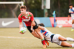 Oakeley Mellish (l) of United Arab Emirates fights for the ball during the match between South Korea and United Arab Emirates of the Asia Rugby U20 Sevens Series 2016 on 12 August 2016 at the King's Park, in Hong Kong, China. Photo by Marcio Machado / Power Sport Images