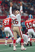 NEW ORLEANS, LA - Quarterback Joe Montana of the San Francisco 49ers signals for a touchdown during Super Bowl XXIV against the Denver Broncos at the Superdome in New Orleans, Louisiana on January 28, 1990. Photo by Brad Mangin.