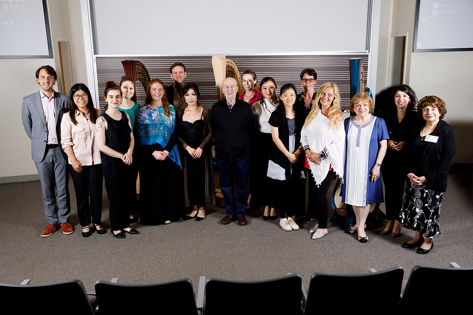 Performers, members of the jury and 2018 6th Composition Contest Winner Uno Alexander Vesje, left, pose for a group photo after the Composition Forum at the 11th USA International Harp Competition at Indiana University in Bloomington, Indiana on Monday, July 8, 2019. (Photo by James Brosher)