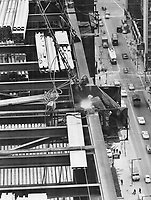 1970 FILE -<br /> <br /> 28 storeys up -- 29 more to go. A construction worker welds steel girders on the 28th storey of Commerce Court-the halfway mark in the rise of the 57-storey building at the corner of King and Bay Sts. Tallest building in the Commonwealth when it is completed; the 784-foot tower sheathed in reflecting metal will boast Canada's swiftest elevators