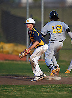 Boca Ciega Pirates first baseman Jake Dolcater (16) waits for a throw as Bo Bichette (19) runs through the bag during a game against the Lakeland Spartans at Boca Ciega High School on March 2, 2016 in St. Petersburg, Florida.  Boca Ciega defeated Lakewood 2-1.  (Mike Janes/Four Seam Images)