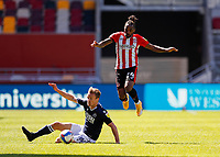 17th April 2021; Brentford Community Stadium, London, England; English Football League Championship Football, Brentford FC versus Millwall; Tariqe Fosu of Brentford is challenged by Shaun Williams of Millwall