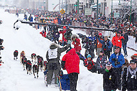 Ray Redington Jr. leaves the starline amongst the crowd during the Ceremonial Start of Iditarod 2012 in Anchorage, Alaska.