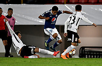 BOGOTA - COLOMBIA – 28 - 02 - 2018:  David Silva (Cent.) jugador de Millonarios (COL), disputan el balon con Angel Romero (Izq.) y Fagner (Der.) jugadores de Corinthians (BRA), durante partido entre Millonarios (COL) y Corinthians (BRA), de la fase de grupos, grupo 7, fecha 1 de la Copa Conmebol Libertadores 2018, en el estadio Nemesio Camacho El Campin, de la ciudad de Bogota. /  David Silva (C) player of Millonarios (COL), fights for the ball with Angel Romero (L) and Fagner (R) players of Corinthians (BRA), during a match between Millonarios (COL) and Corinthians (BRA), of the group stage, group 7, 1st date for the Conmebol Copa Libertadores 2018 in the Nemesio Camacho El Campin stadium in Bogota city. VizzorImage / Luis Ramirez / Staff.